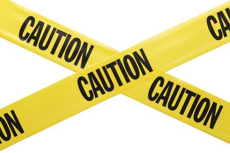 Yellow Plastic Caution Tape Criss Crossing Isolated on White Background.