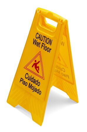 Yellow Plastic Caution Wet Floor Sign isolated on a white background. photo
