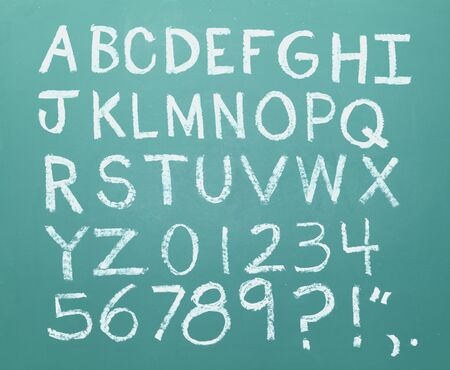 All the letters of the alphabet drawn in chalk on a green chalkboard. photo