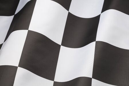 Single Checkered Flag with Wave in it Isolated on White Background. photo