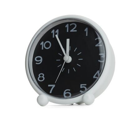 12 oclock: Black and White Clock almost at 12 Oclock. Isolated on White Background.