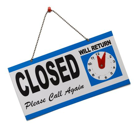 Hanging door sign that says closed and is isolated on a white background. photo