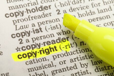 Yellow Highlighter And Marked Copyright Dictionary. Stok Fotoğraf