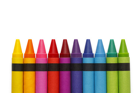 crayons: Craoyons lined up in rainbow isolated on white background.