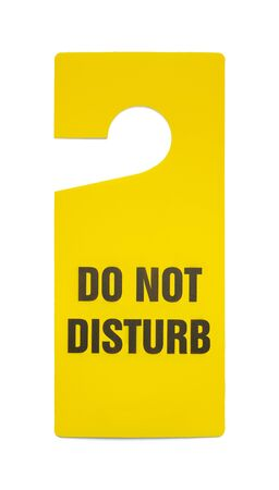 do not enter warning sign: Yellow Plastic Do Not Disturb Sign Isolated on White Background. Stock Photo