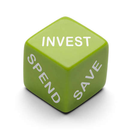 investment strategy: Green Dice with words Invest, Spend and Save Isolated on White Background.