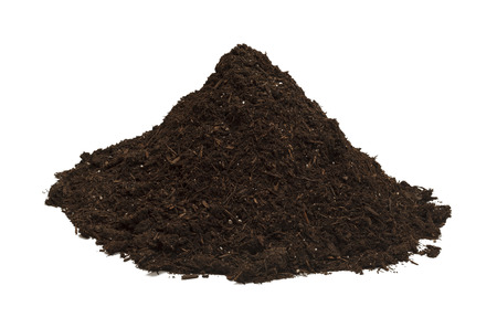 compost: Brown Soil in a Dirt Mound Isolated on White Background. Stock Photo