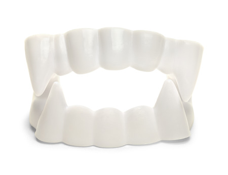 White Plastic Vampire Teeth Isolated on White background,