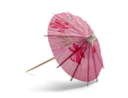 paper umbrella: Pink Cocktail Umbrella Isolated on White Background. Stock Photo