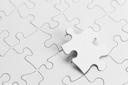 pieces: White Puzzle with Copyspace and Puzzle Piece. Stock Photo