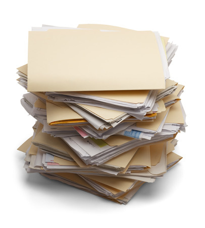 order chaos: Files stacking up in a messy order isolated on white background. Stock Photo