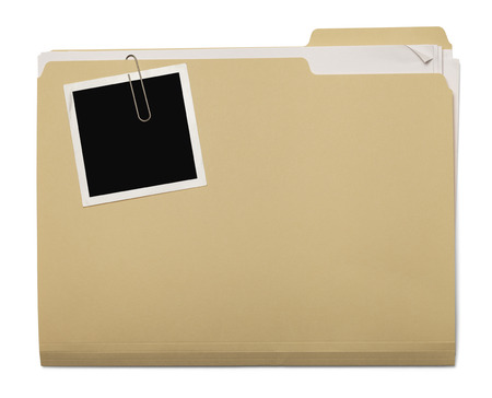 Folder with Papers Stuffed Inside with Photo on Top Isolated on White Background. Foto de archivo