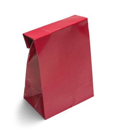 lifestyle shopping: Folded Red Paper Bag Lunch with Copy Space Isolated on White Background.