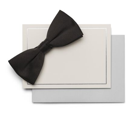 social grace: Black Bow Tie with Card and Envelope isolated on White Background. Stock Photo
