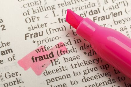 white collar crime: The Word Fraud Highlighted in Dictionary with Yellow Marker Highlighter Pen.