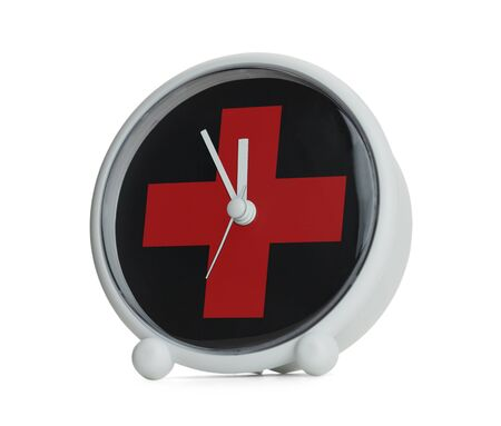 Clock with Red Medical Cross Isolated on White Background. Imagens