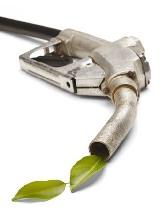 converting: Old Gas pump with leaves coming out. Converting to Green, Isolated on White Background. Stock Photo