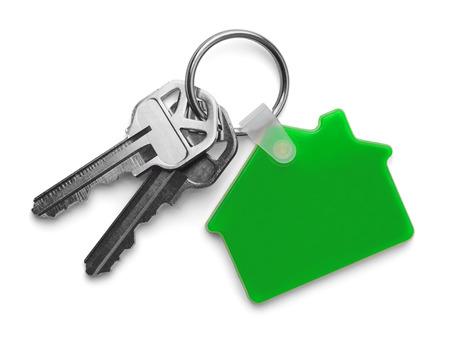 house keys: House keys with Green House Keychain Isolated on White Background.