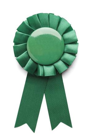 awareness ribbon: Green ribbon award badge isolated on white background.