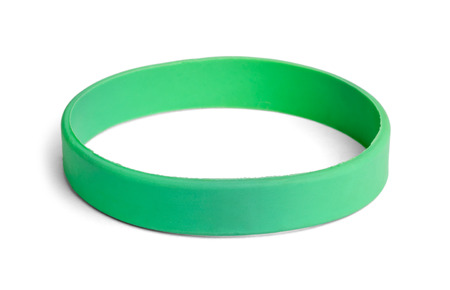 nephropathy: Blank rubber plastic stretch green bracelet isolated on white background. Stock Photo