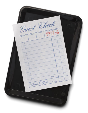 Blank Resturant Receipt on Tip Tray Isolated on a White Background.