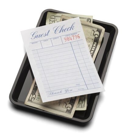 dining out: Resturant bill with money on payment tray isolated on a white background.