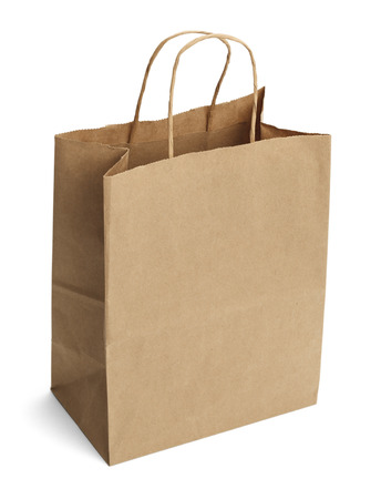 closeup on bags: Brown Shopping Bag with Handles Isolated on White Background.