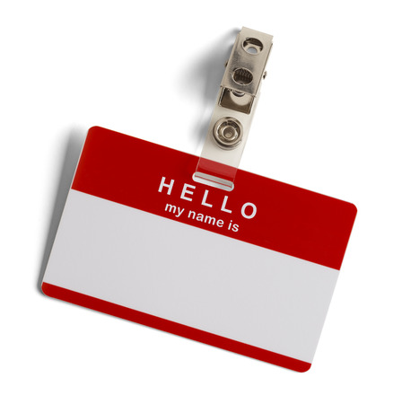 Red and White Plastic Name Tag with Hello My Name Is Isolated on White Background. photo