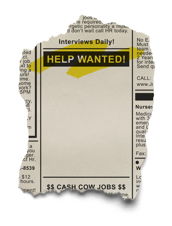 Want Ads for Job Search on Torn News Paper Isolated on White Background. Archivio Fotografico