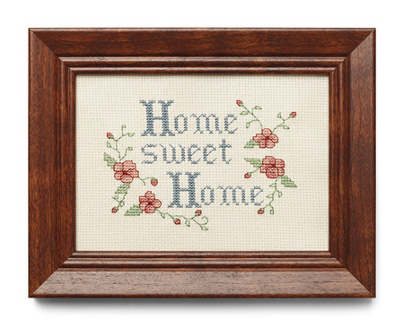 sampler: Cross Stitch in Wood Frame Isolated on White Background. Stock Photo