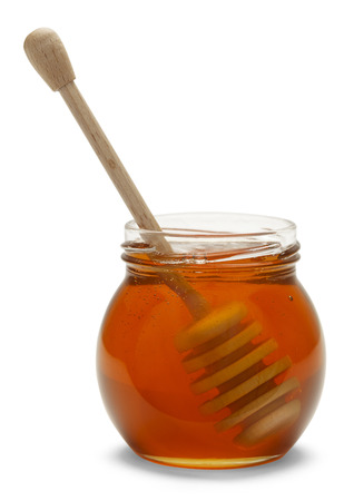 tidbit: Honey Jar with Wood Dipper Isolated on White  Background. Stock Photo