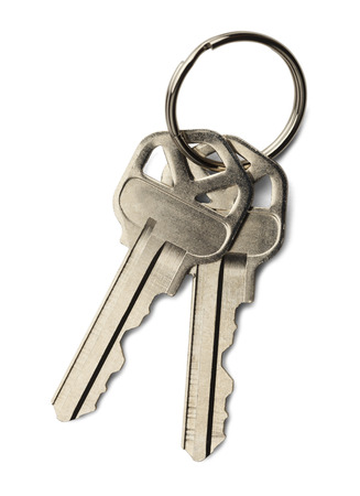 Two house keys on a key ring isolated on a  white background.
