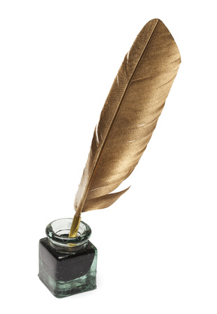 Feather Quill and Glass Ink Bottle Isolated on White Background. Foto de archivo