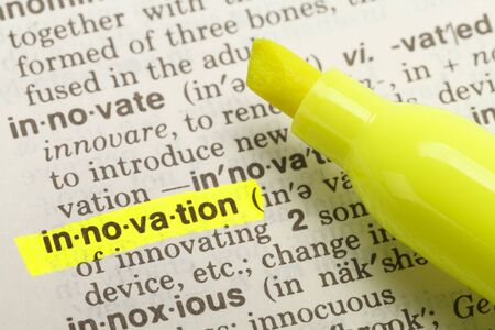 english dictionary: The Word Innovation Highlighted in Dictionary with Yellow Marker Highlighter Pen.
