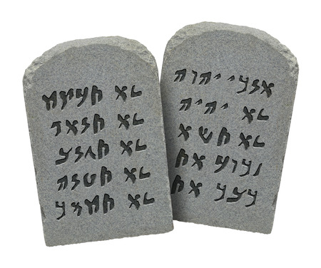 Two Stones with Ten Commandments in Ancient Hebrew Isolated on White Background. photo