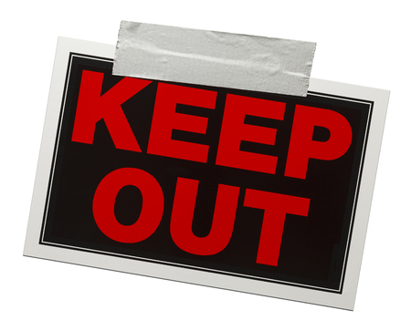 keep out: Red and black keep out sign with tape holding it up isolated on a white background. Stock Photo