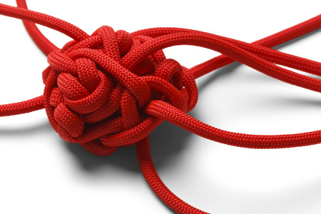 Red Rope in A Tangled Mess Isolated on White Background.