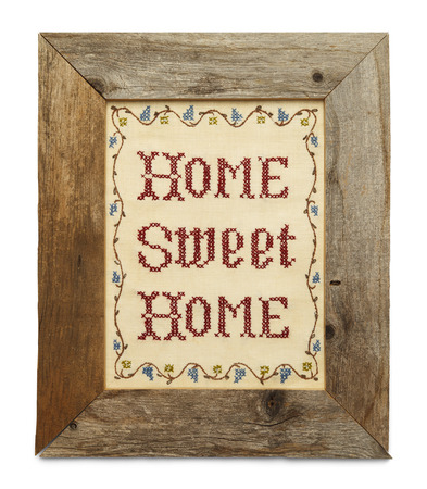 Home Sweet Home Cross Stitch in Rustic Wood Frame Isolated on White Background.