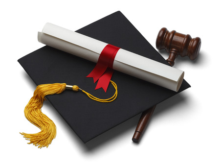Black Graduation Hat with Degree and Gavel Isolated on White Background. photo