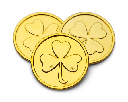 Three Gold Coins with Three Leaf Clover Desgin Isolated on White Background. photo