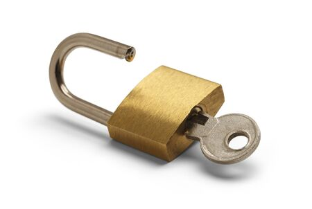Brass Padlock Unlocked with Key Isolated on White Background. Stockfoto