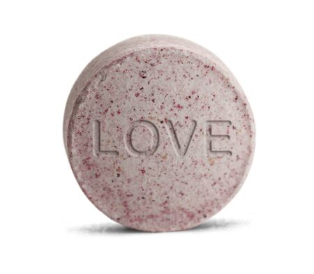 ecstasy pill: Pink Love Potion medicine isolated on a white background.