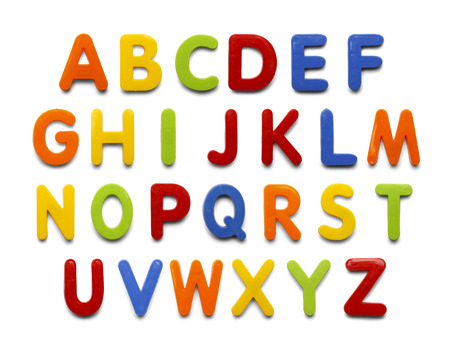 Magnetic Plastic ABC Letters Isolated on White Background. Standard-Bild