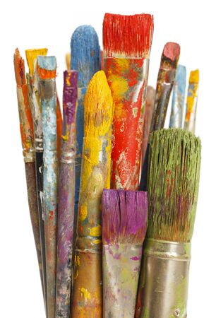 Group of Paint Brushes with Differnet Color Paints on Them Isolated on White Background.