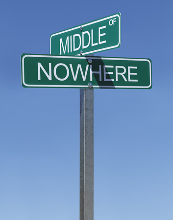 cast off: Two Green Street Signs Middle of Nowhere on a Metal Pole with Blue Sky Background.