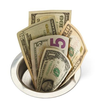 monies: Cash Money Going Down Sink Drain Isolated on White Background. Stock Photo
