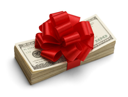 cash back: Christmas Bonus Stack of Cash With Red Bow Isolated on White Back Ground.