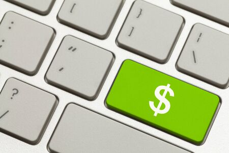 dollar sign: Cluse Up of Green Money Key with Cash Symbol on a Keyboard.