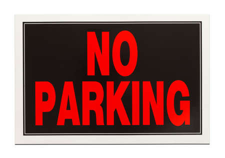 no parking: Black and Red Plastic No Parking Sign Isolated on White Background. Stock Photo