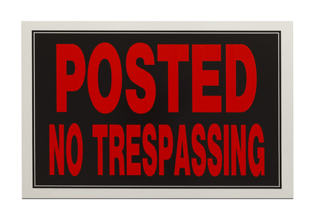 Red and Black, Posted No Trespassing Sign Isolated on White Background. photo